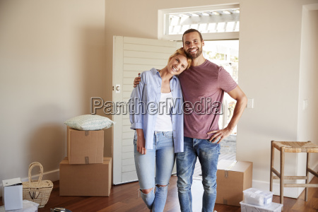 portrait of couple surrounded by boxes