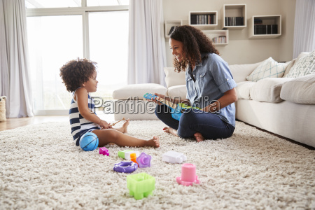 young black mother playing with toddler