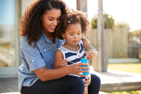 young mixed race mother and daughter