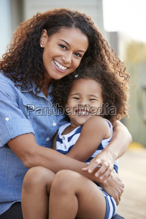 mixed race mother and young daughter