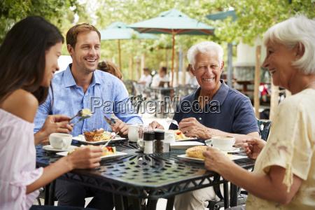 senior parents with adult children enjoying