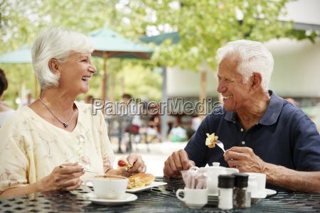 portrait of senior couple enjoying meal