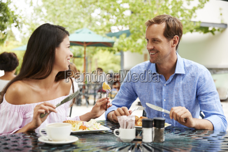 portrait of couple enjoying meal at