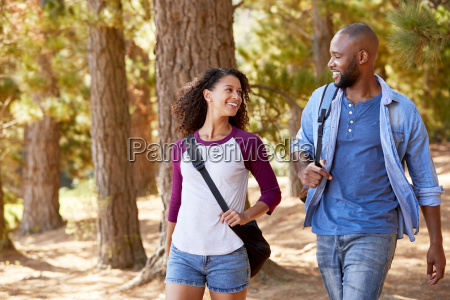 couple on hiking adventure in wooded