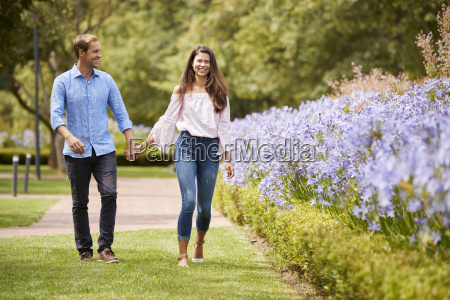 couple holding hands on romantic walk