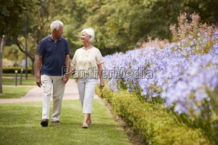 senior couple holding hands on romantic