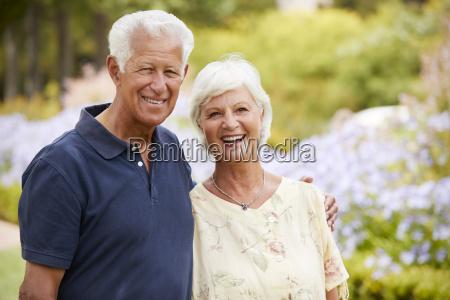 portrait of senior couple enjoying walk