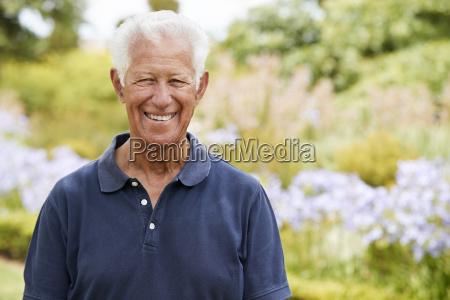 portrait of senior man enjoying walk
