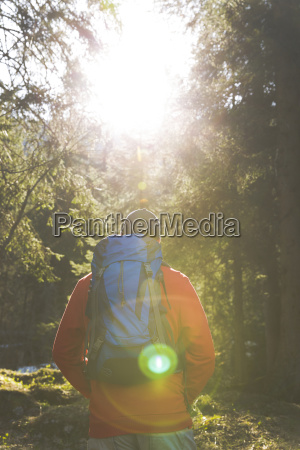 hiking man with blue backpack and