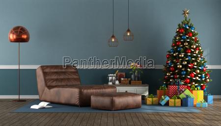 blaues wohnzimmer mit weihnachtsbaum