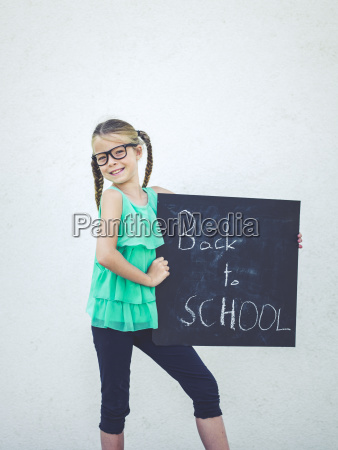 blond beautiful girl with glasses is