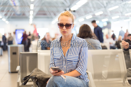 woman using her cell phone while