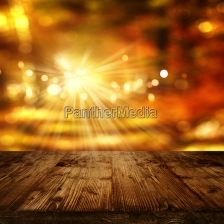 sunny autumn background and wooden table