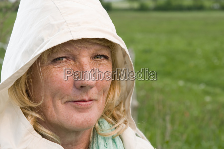 blond mature woman with hood