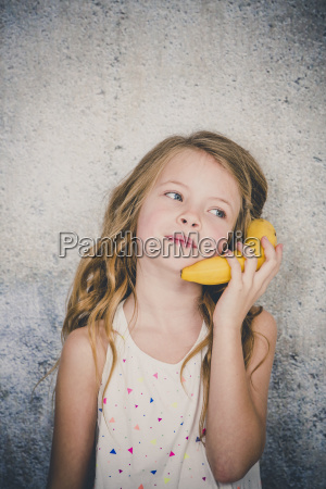 blond pretty girl is doing phone