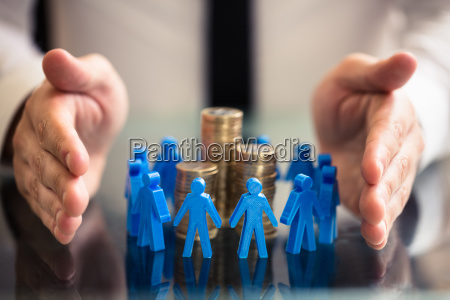 protecting blue human figures surrounding stacked