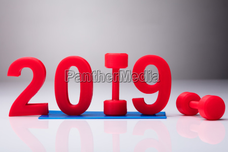 year 2019 over exercise mat near