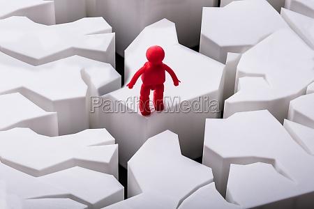 human figure standing on damaged white