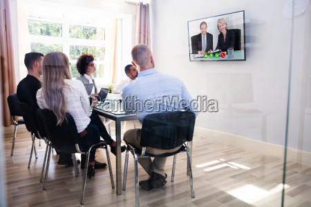 group of diverse businesspeople video conferencing