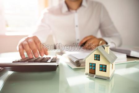 businessmans hand calculating invoice
