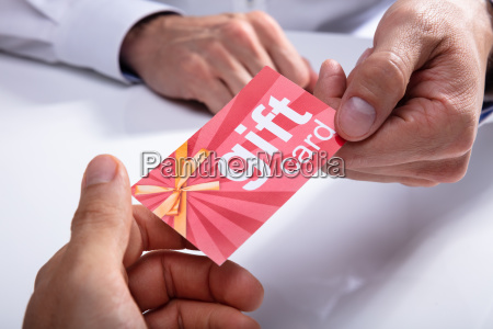 businessman giving gift card to his