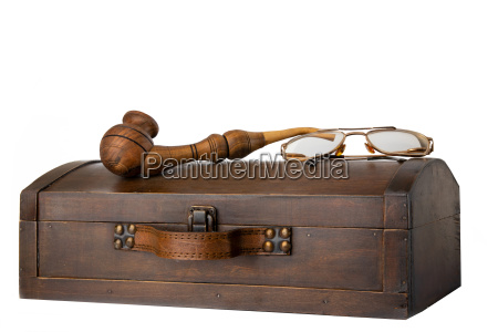 old wooden chest with tobacco pipe