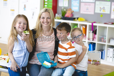 pupils enjoy a healthy snack with