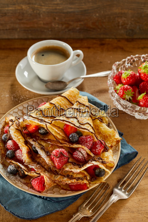 tasty summer breakfast with berry pancakes