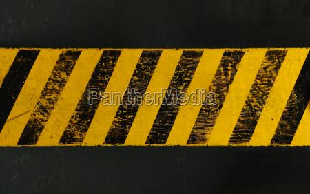 yellow background with black grunge hazard