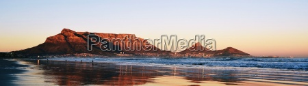 seascape with table mountain at sunrise