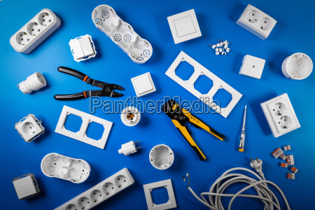 electrical tools and equipment on blue