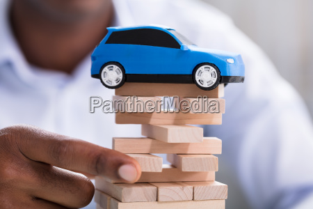 person holding blocks with toy blue