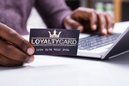person holding loyalty card