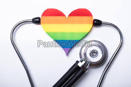 examining rainbow heart with stethoscope