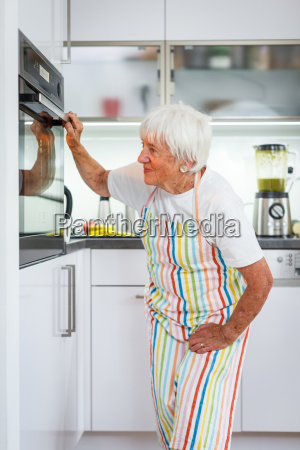 senior woman cooking in the kitchen