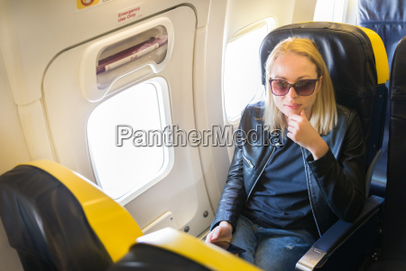 woman on airplane during commercial flight