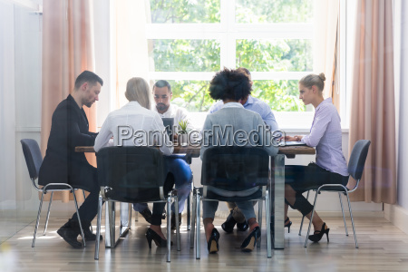 group of businesspeople sitting in office
