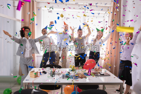 excited businesspeople having fun raising their