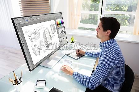 designer zeichnung koffer am computer mit