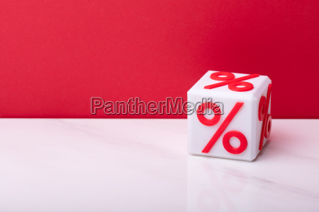 cubic block with red percentage symbol