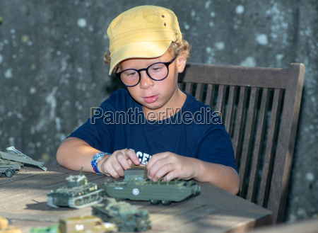 little boy with a yellow cap