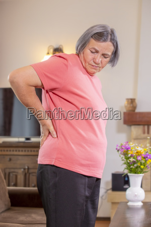 senior woman suffering from backache at