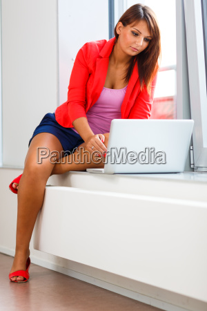 pretty young woman working on a