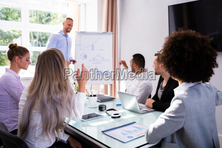 group of businesspeople looking at manager