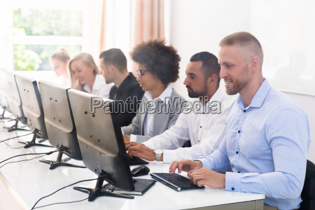 business executives using computer