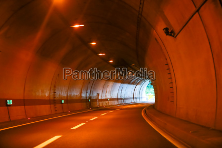 curved empty highway tunnel