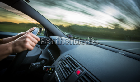 man driving a car moving fast