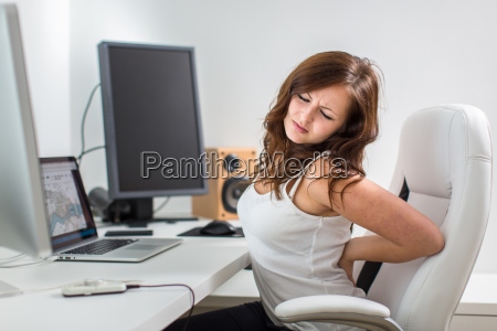 young woman sitting at her computer