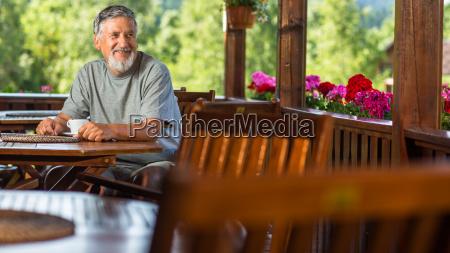 handsome senior man enjoying his morning