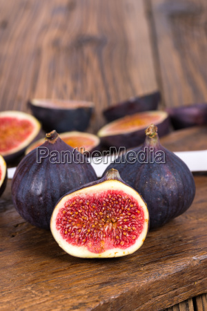 sweets figs and a knife on
